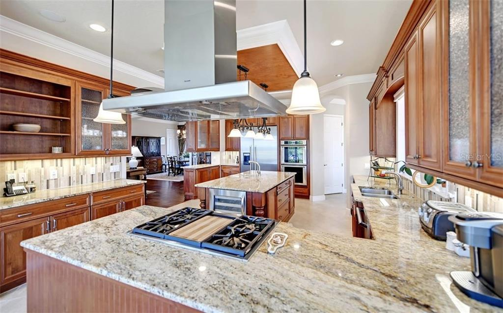 Chef's kitchen - Single Family Home for sale at 7903 Longbay Blvd, Sarasota, FL 34243 - MLS Number is A4449717