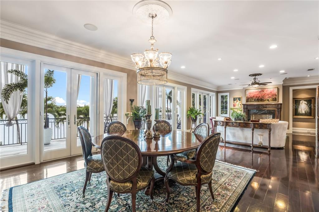 Custom crown molding, elegant lighting and decorative ceiling fans make this home warm and inviting. - Single Family Home for sale at 6438 Hollywood Blvd, Sarasota, FL 34231 - MLS Number is A4449895