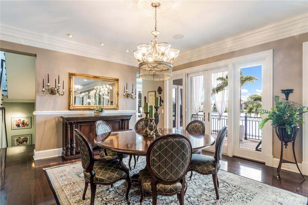 Imagine the fabulous dinner parties you will host in this gorgeous dining room. - Single Family Home for sale at 6438 Hollywood Blvd, Sarasota, FL 34231 - MLS Number is A4449895