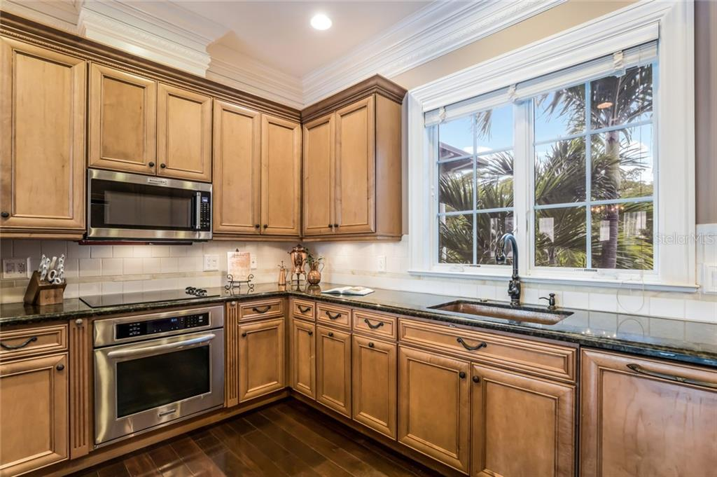 A hammered copper sink brings charm and function to the space. - Single Family Home for sale at 6438 Hollywood Blvd, Sarasota, FL 34231 - MLS Number is A4449895
