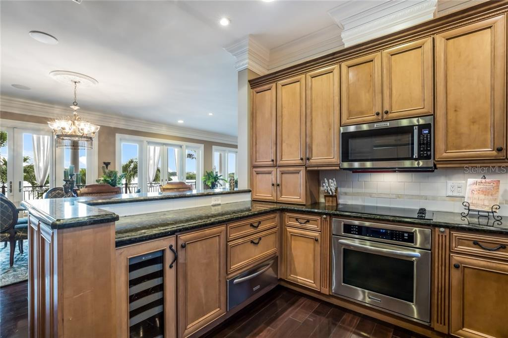 Effortlessly entertain with your very own warming drawer and under-cabinet wine cooler. - Single Family Home for sale at 6438 Hollywood Blvd, Sarasota, FL 34231 - MLS Number is A4449895