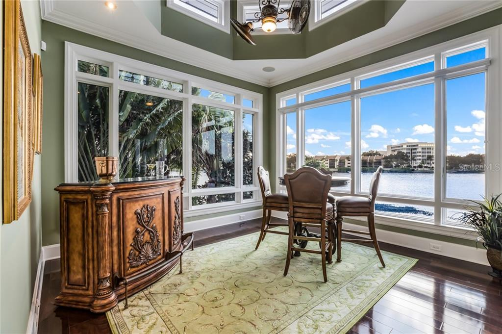 The solarium provides magnificent views of the waterfront with floor to ceiling windows. - Single Family Home for sale at 6438 Hollywood Blvd, Sarasota, FL 34231 - MLS Number is A4449895
