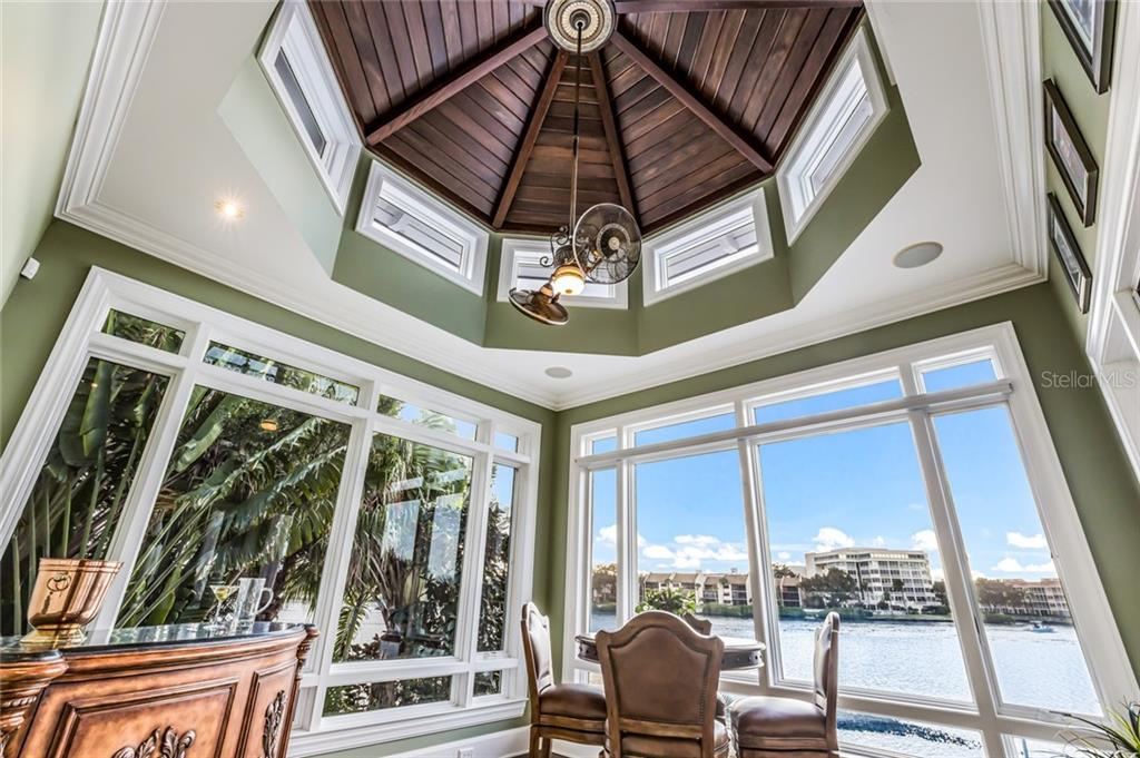 The solarium features a one-of-a-kind round cupola with a beautiful wood tongue and groove ceiling and beams. - Single Family Home for sale at 6438 Hollywood Blvd, Sarasota, FL 34231 - MLS Number is A4449895