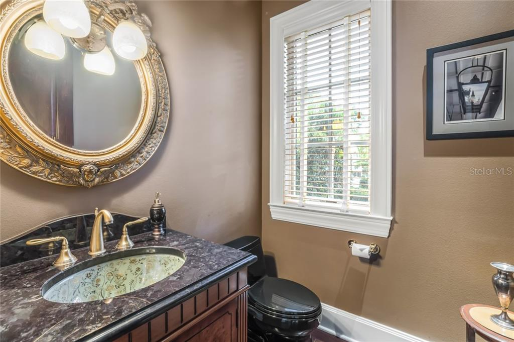 The powder room is conveniently located on the main living level. - Single Family Home for sale at 6438 Hollywood Blvd, Sarasota, FL 34231 - MLS Number is A4449895