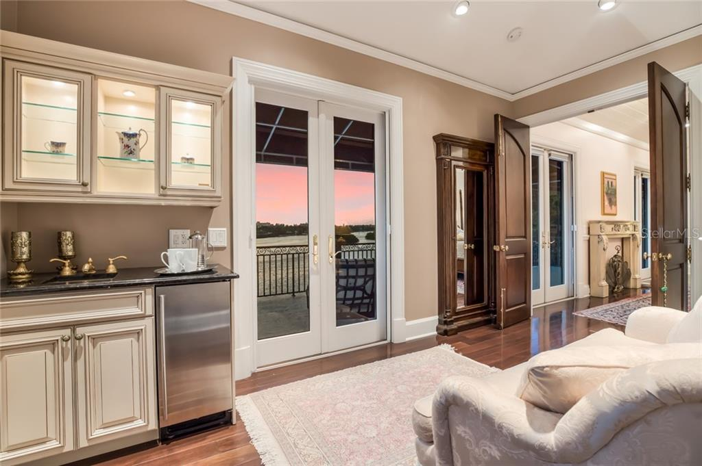 As you enter the master suite you will find a peaceful 'Morning Room', perfect for preparing a hot morning beverage or late night snack at the morning kitchen. - Single Family Home for sale at 6438 Hollywood Blvd, Sarasota, FL 34231 - MLS Number is A4449895