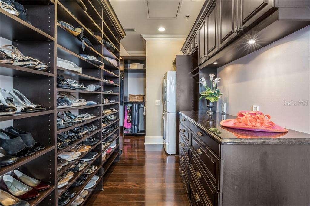 This is the dressing room you've always dreamed of, with endless custom-built shelving and an abundant amount of storage. - Single Family Home for sale at 6438 Hollywood Blvd, Sarasota, FL 34231 - MLS Number is A4449895