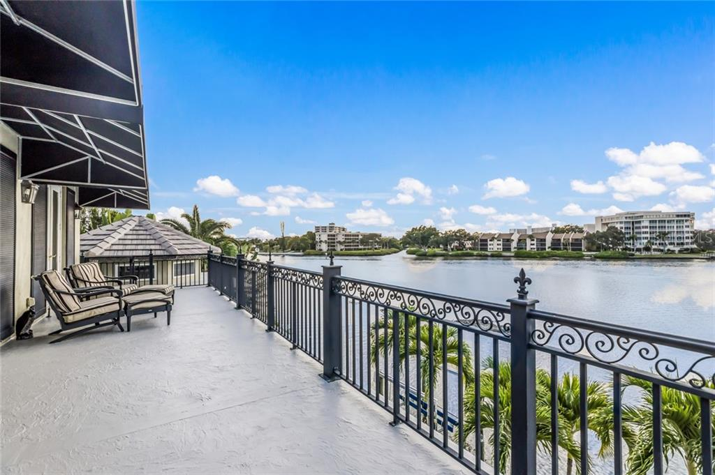The master suite balcony offers a perfect retreat. - Single Family Home for sale at 6438 Hollywood Blvd, Sarasota, FL 34231 - MLS Number is A4449895