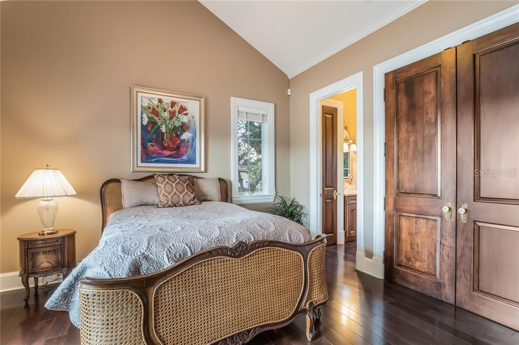 Guests will never want to leave this charming guest suite with an en-suite bath and french doors leading to the balcony. - Single Family Home for sale at 6438 Hollywood Blvd, Sarasota, FL 34231 - MLS Number is A4449895