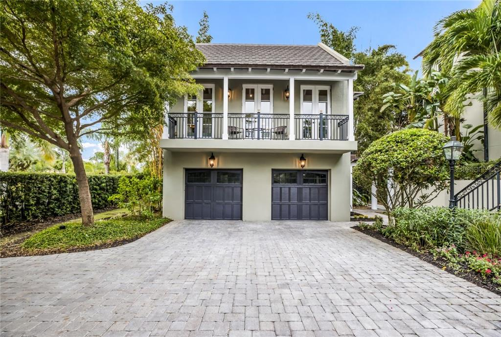 The separate carriage house includes a 2-car garage with a 588 sq.ft. mother-in-law or guest suite with a private entrance and spacious balcony overlooking the courtyard. - Single Family Home for sale at 6438 Hollywood Blvd, Sarasota, FL 34231 - MLS Number is A4449895