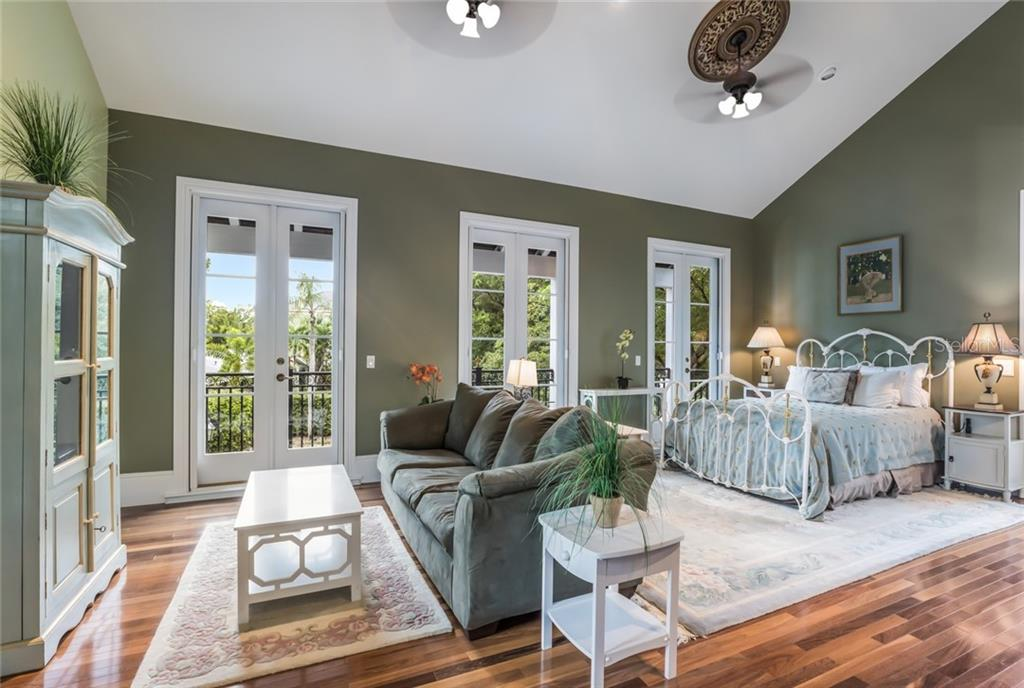 The open layout of the carriage house provides plenty of room for watching TV or enjoying a good book. - Single Family Home for sale at 6438 Hollywood Blvd, Sarasota, FL 34231 - MLS Number is A4449895