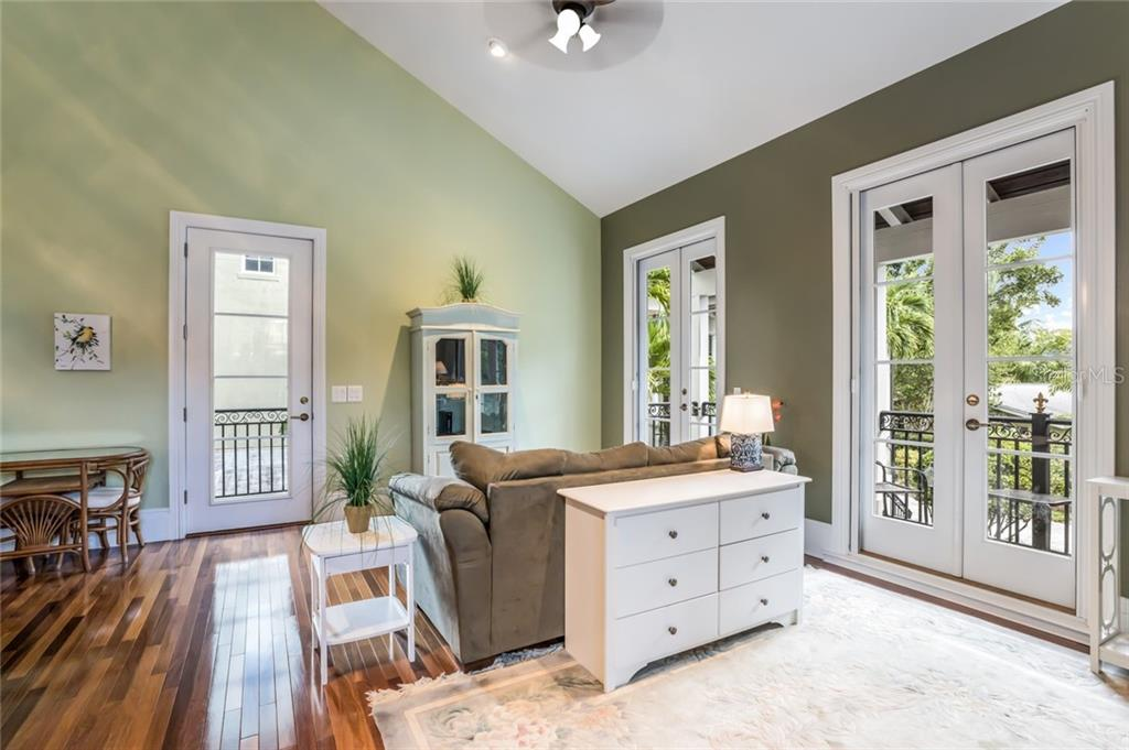 The carriage house features beautiful hardwood floors and french doors that lead to a private balcony. - Single Family Home for sale at 6438 Hollywood Blvd, Sarasota, FL 34231 - MLS Number is A4449895