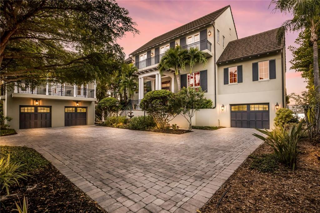 A private paver courtyard provides ample space for parking, along with a detached 2-car garage below the carriage house and another 1-car garage under the main house. - Single Family Home for sale at 6438 Hollywood Blvd, Sarasota, FL 34231 - MLS Number is A4449895