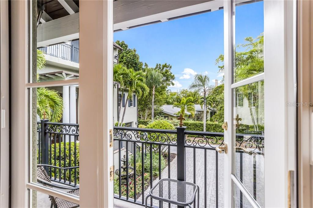 Enjoy your favorite beverage on the carriage house balcony. - Single Family Home for sale at 6438 Hollywood Blvd, Sarasota, FL 34231 - MLS Number is A4449895