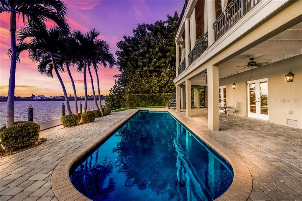 Take a dip in the sparkling 35-foot saltwater lap pool, complete with outdoor shower. - Single Family Home for sale at 6438 Hollywood Blvd, Sarasota, FL 34231 - MLS Number is A4449895