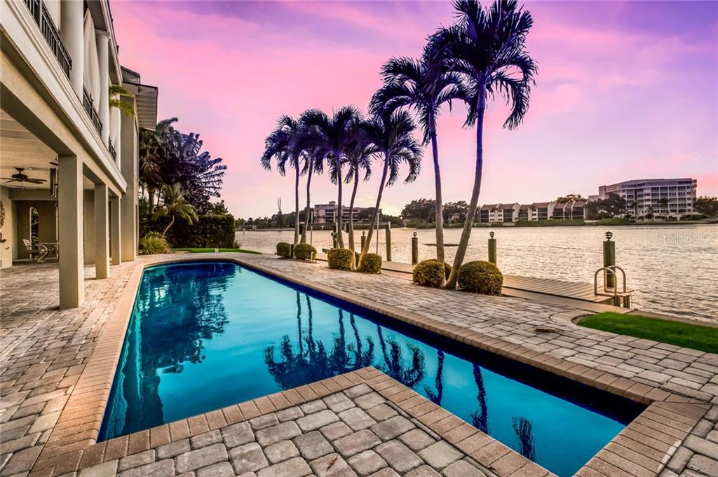 Enjoy the amazing sunsets poolside or from one of the spacious balconies. - Single Family Home for sale at 6438 Hollywood Blvd, Sarasota, FL 34231 - MLS Number is A4449895
