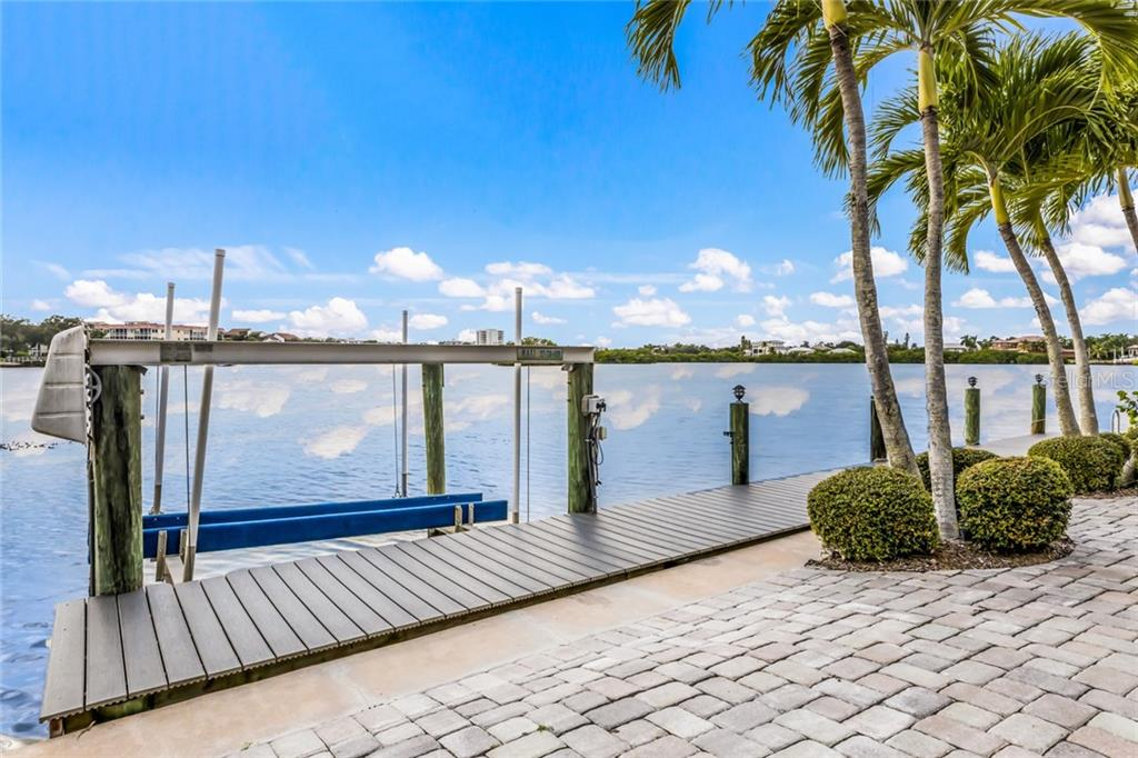 Enjoy the 50-foot dock that was just updated with new composite decking, plus a 7,000-pound boat lift with water and electric. - Single Family Home for sale at 6438 Hollywood Blvd, Sarasota, FL 34231 - MLS Number is A4449895