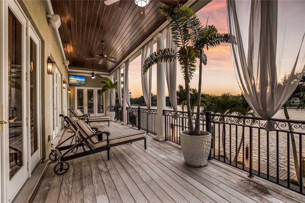 The main floor balcony is perfect for dolphin watching as you capture the colorful sunset. All balconies and outdoor stairs are made of ipe wood which is naturally resistant to rot, weather, and insects. - Single Family Home for sale at 6438 Hollywood Blvd, Sarasota, FL 34231 - MLS Number is A4449895