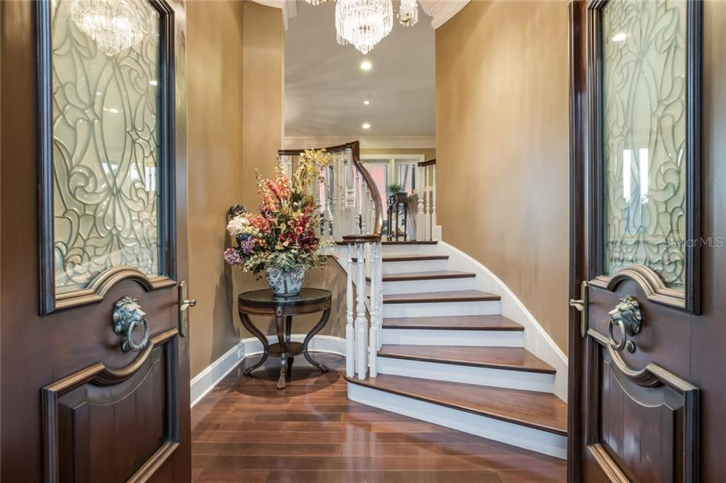 The gracious foyer leads to the open living space. - Single Family Home for sale at 6438 Hollywood Blvd, Sarasota, FL 34231 - MLS Number is A4449895