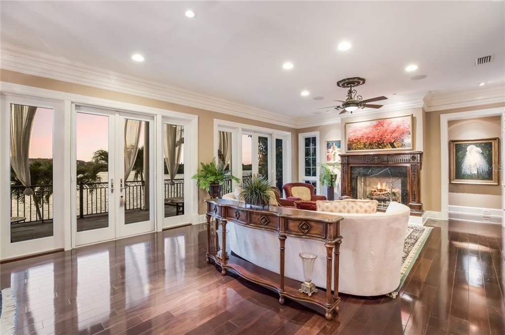 The living area is all about the breathtaking views that are captured through a wall of windows and doors. - Single Family Home for sale at 6438 Hollywood Blvd, Sarasota, FL 34231 - MLS Number is A4449895