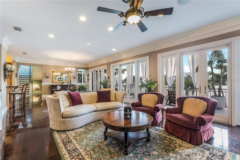 The bright and inviting living and dining area flow seamlessly, making entertaining a breeze. - Single Family Home for sale at 6438 Hollywood Blvd, Sarasota, FL 34231 - MLS Number is A4449895