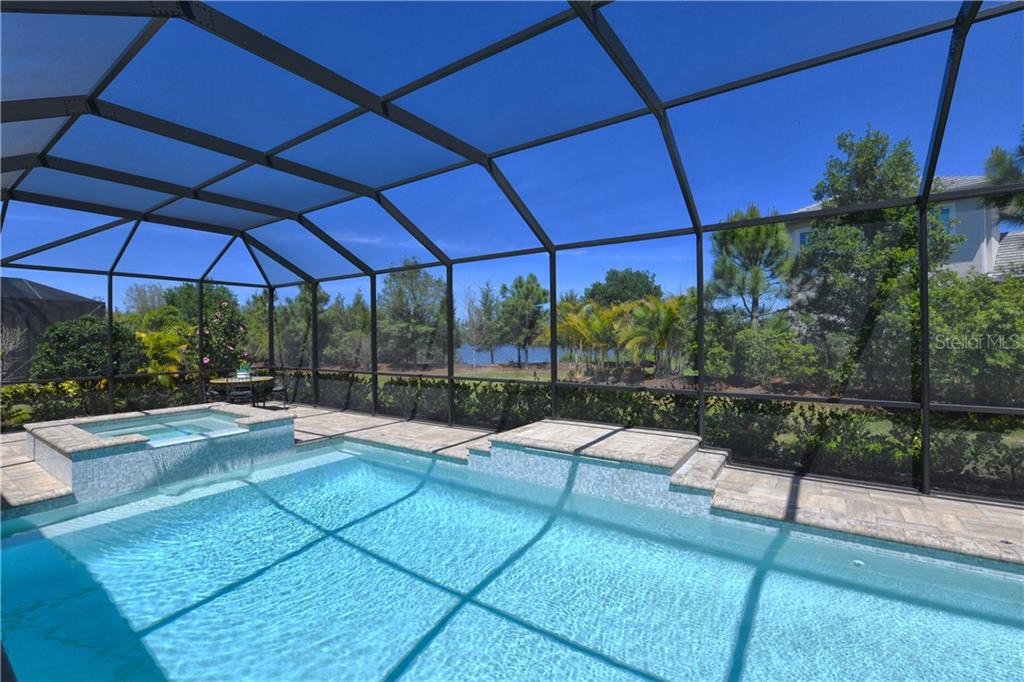 Single Family Home for sale at 6923 Devon Cv, Lakewood Ranch, FL 34202 - MLS Number is A4450411