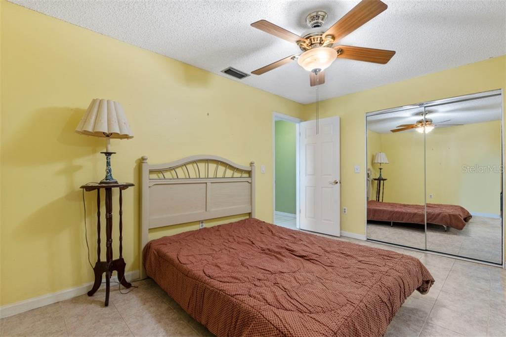 Bedroom 2 - Single Family Home for sale at 6524 Waterford Cir, Sarasota, FL 34238 - MLS Number is A4450568