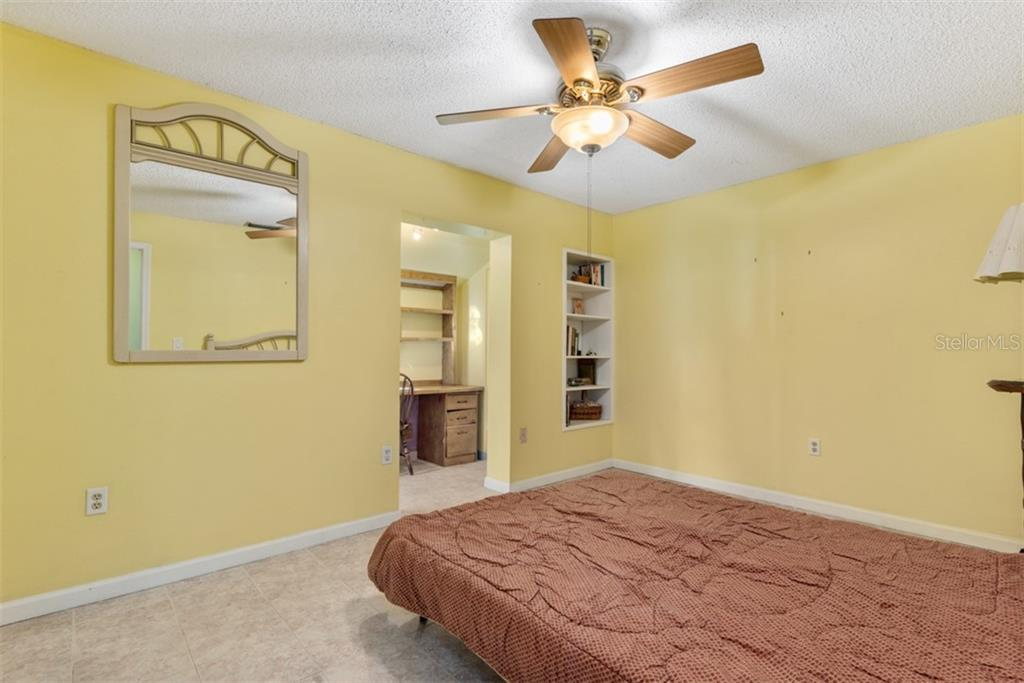 Bedroom 2 with desk work area - Single Family Home for sale at 6524 Waterford Cir, Sarasota, FL 34238 - MLS Number is A4450568