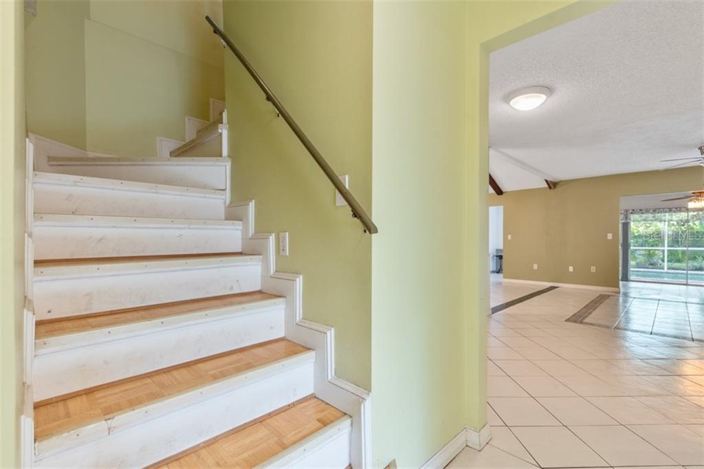 upstairs bonus room with 1/2 bath - Single Family Home for sale at 6524 Waterford Cir, Sarasota, FL 34238 - MLS Number is A4450568