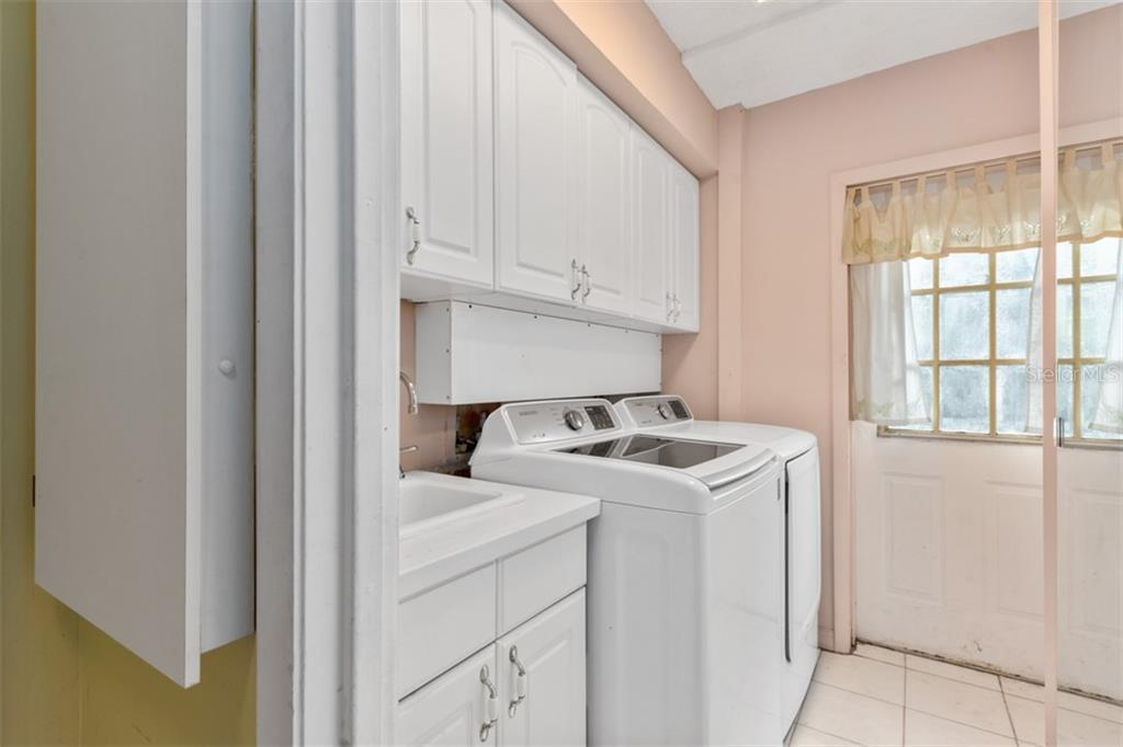Indoor laundry and iron board - Single Family Home for sale at 6524 Waterford Cir, Sarasota, FL 34238 - MLS Number is A4450568
