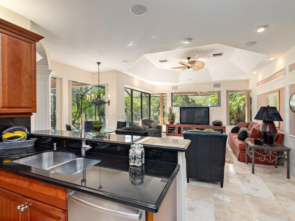 Kitchen/family room - Single Family Home for sale at 6826 Turnberry Isle Ct, Lakewood Ranch, FL 34202 - MLS Number is A4450601