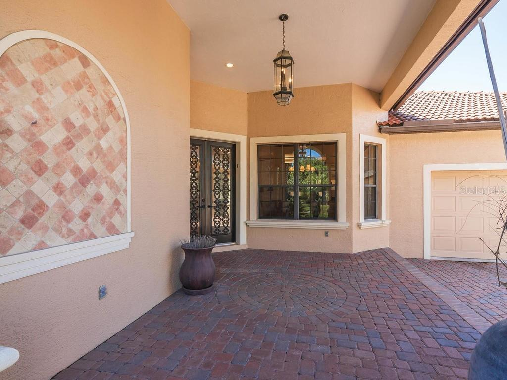 Front entry - Single Family Home for sale at 6826 Turnberry Isle Ct, Lakewood Ranch, FL 34202 - MLS Number is A4450601
