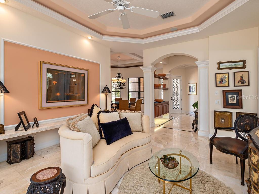 Living Room looking towards foyer & dining - Single Family Home for sale at 6826 Turnberry Isle Ct, Lakewood Ranch, FL 34202 - MLS Number is A4450601