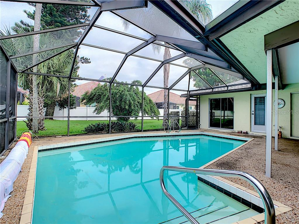 Heated, SALT WATER pool also has a solar cover. View is looking to the back of the yard. - Single Family Home for sale at 7006 18th Ave W, Bradenton, FL 34209 - MLS Number is A4450658