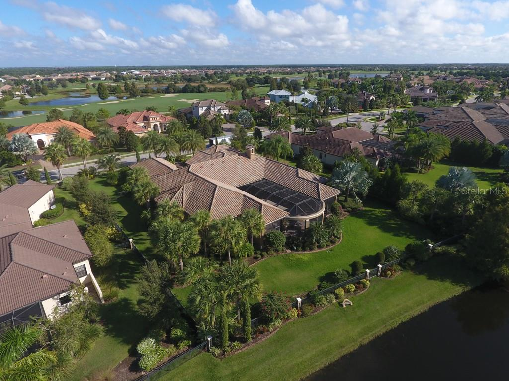Richly landscaped exterior - Single Family Home for sale at 15212 Linn Park Ter, Lakewood Ranch, FL 34202 - MLS Number is A4450793