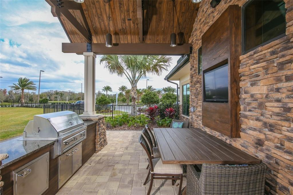 Outdoor kitchen at The Lodge - Single Family Home for sale at 15212 Linn Park Ter, Lakewood Ranch, FL 34202 - MLS Number is A4450793
