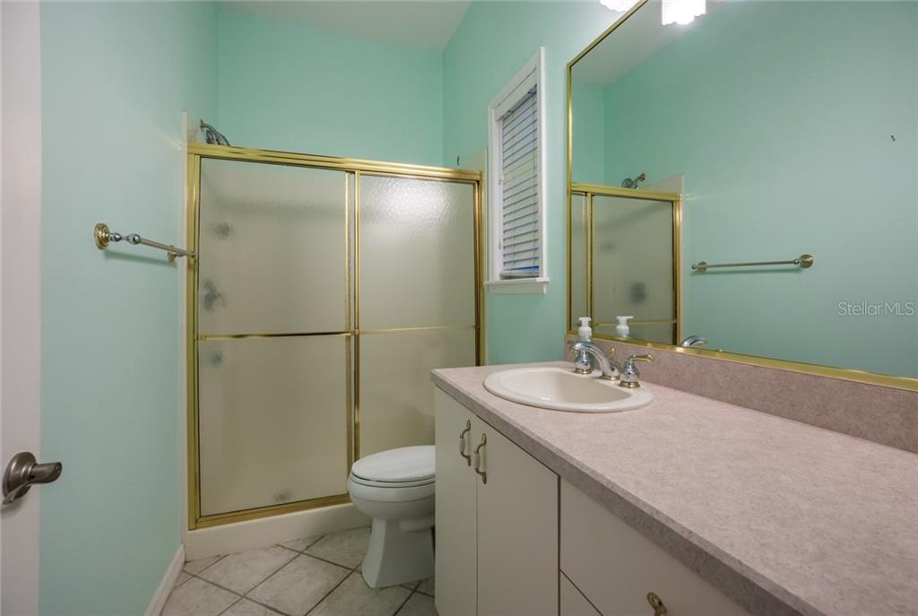 Bathroom in the MIL suite - Single Family Home for sale at 21306 Deer Pointe Xing, Bradenton, FL 34202 - MLS Number is A4450802