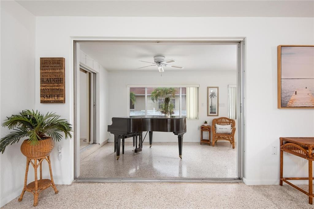 The 2nd bedroom is of ample size and offers plenty of light. The terrazzo floors are in need of a bit of work, but are ready for your updates. - Single Family Home for sale at 691 Tarawitt Dr, Longboat Key, FL 34228 - MLS Number is A4451584