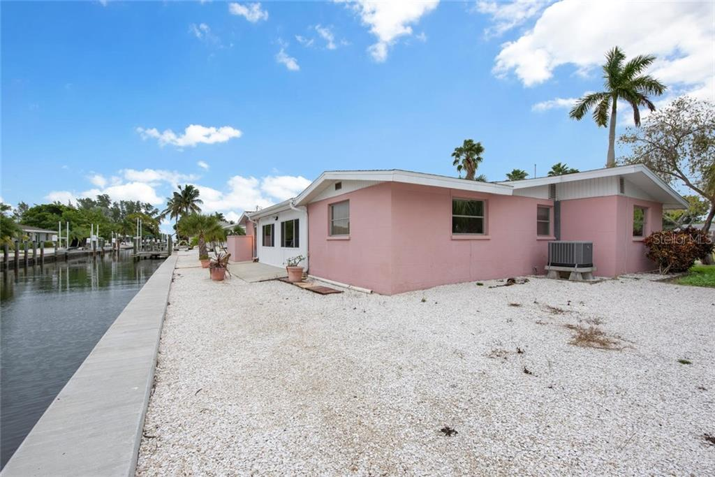 Get ready to start enjoying Island life at it's best - Single Family Home for sale at 691 Tarawitt Dr, Longboat Key, FL 34228 - MLS Number is A4451584