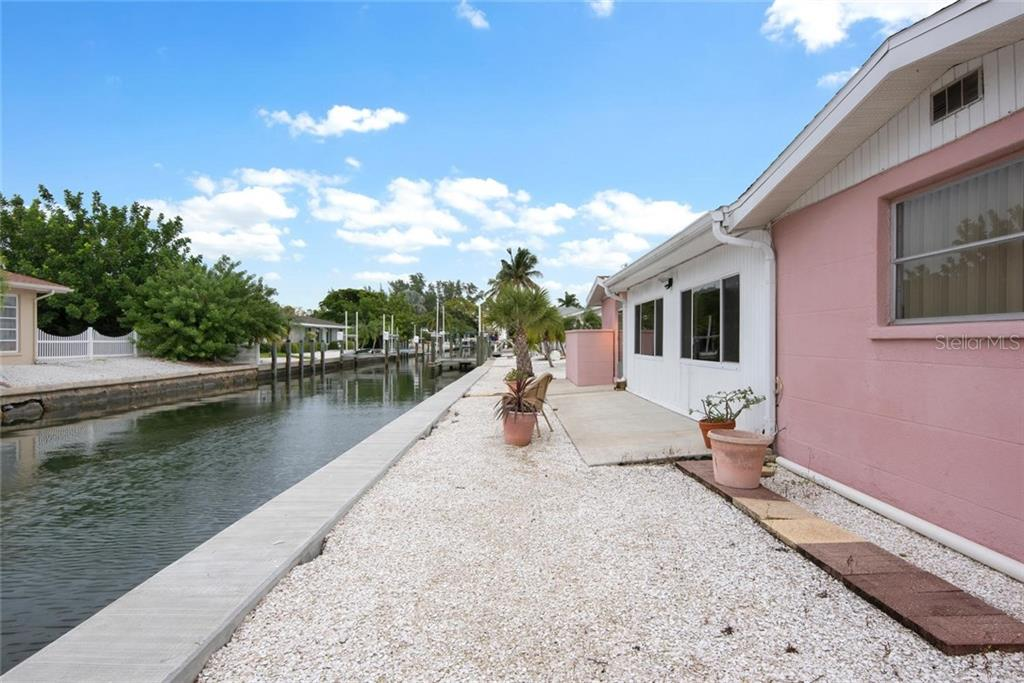 Water for as far as the eye can see! - Single Family Home for sale at 691 Tarawitt Dr, Longboat Key, FL 34228 - MLS Number is A4451584