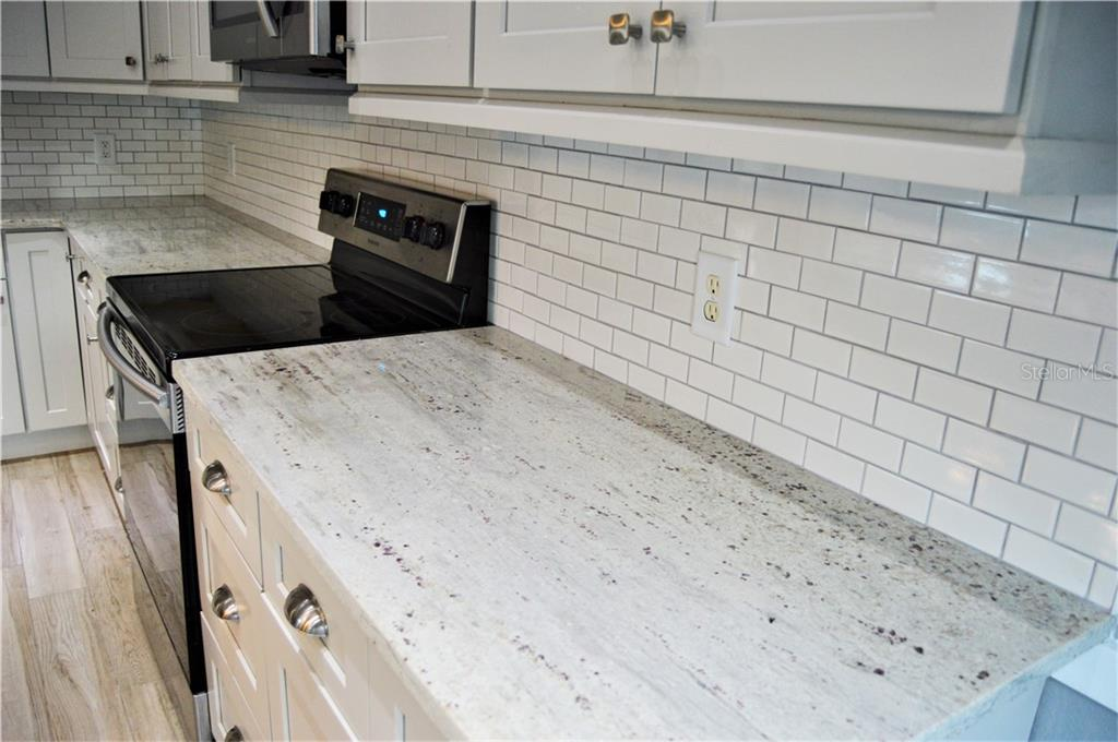 Granite Countertops with Subway Tiled Backsplash - Townhouse for sale at 14831 Skip Jack Loop, Lakewood Ranch, FL 34202 - MLS Number is A4451607