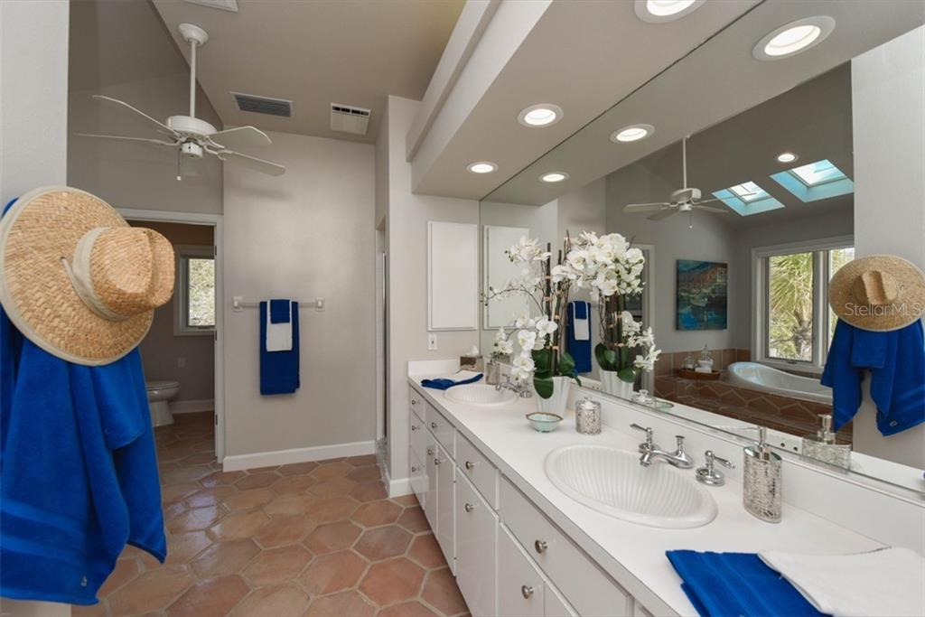 Master Bath with dual sinks, walk in shower, separate toilet and bidet. - Single Family Home for sale at 1027 N Casey Key Rd, Osprey, FL 34229 - MLS Number is A4451976