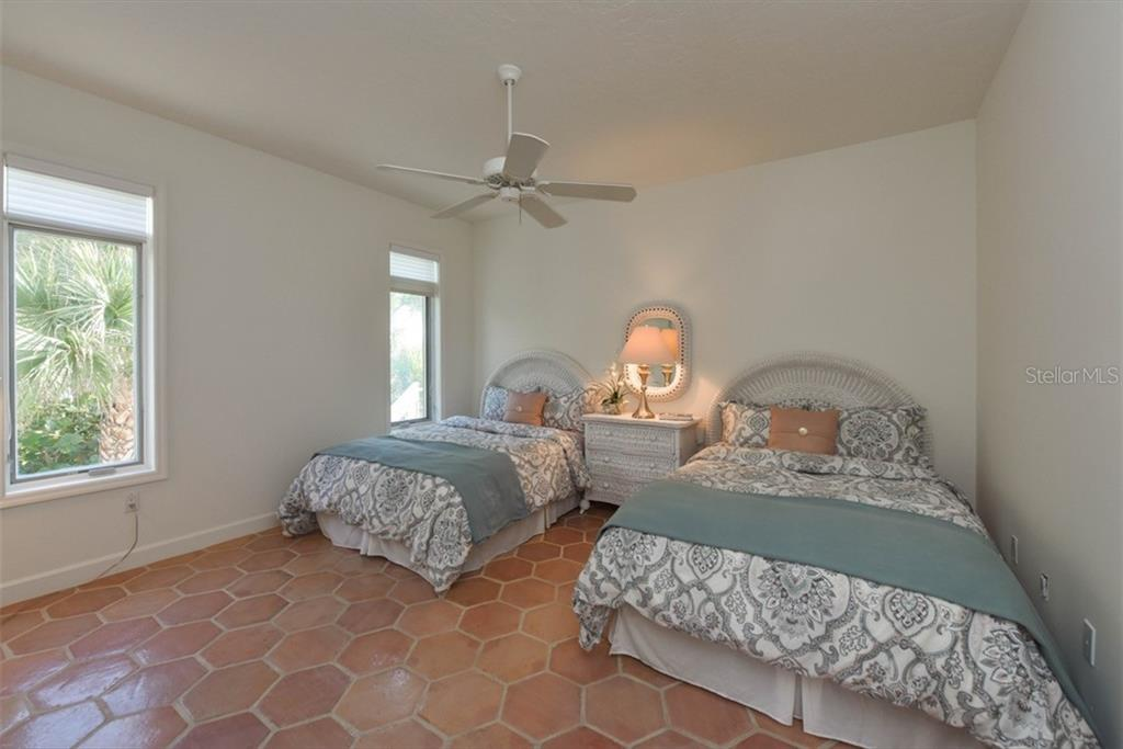 Large 2nd bedroom, enough to allow 2 full size beds. Views down the coastline from this room. - Single Family Home for sale at 1027 N Casey Key Rd, Osprey, FL 34229 - MLS Number is A4451976