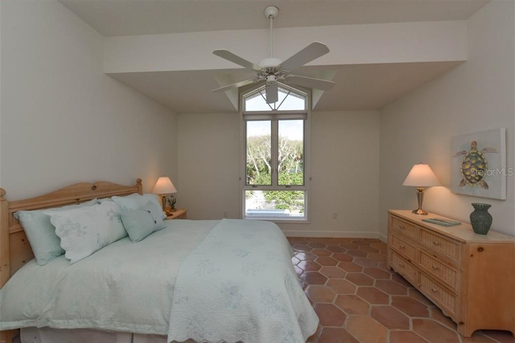 Bedroom 3, another ample sized room with walk in closet. - Single Family Home for sale at 1027 N Casey Key Rd, Osprey, FL 34229 - MLS Number is A4451976