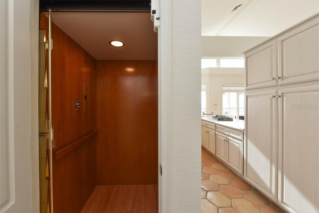 Elevator from lower garage level. - Single Family Home for sale at 1027 N Casey Key Rd, Osprey, FL 34229 - MLS Number is A4451976
