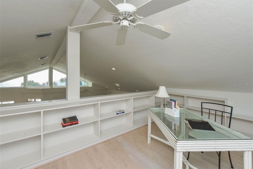 Upper level loft with it's own private balcony. Built-in Storage and incredible vistas - Single Family Home for sale at 1027 N Casey Key Rd, Osprey, FL 34229 - MLS Number is A4451976