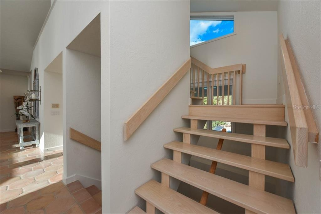 Stairway to loft. All other areas have elevator access. - Single Family Home for sale at 1027 N Casey Key Rd, Osprey, FL 34229 - MLS Number is A4451976