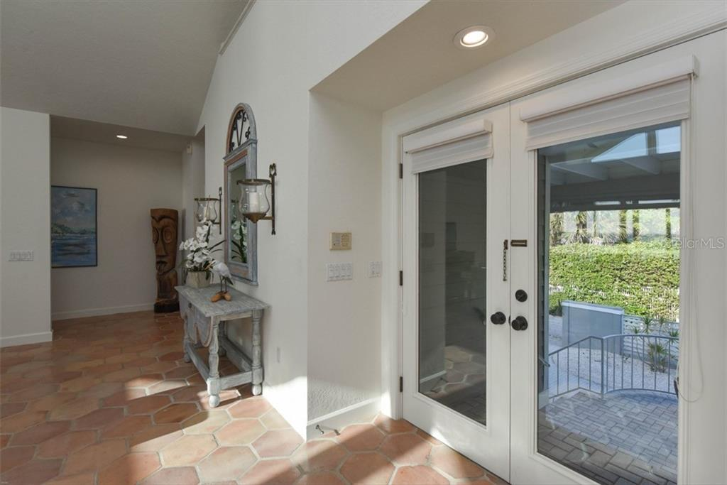 Entrance - Single Family Home for sale at 1027 N Casey Key Rd, Osprey, FL 34229 - MLS Number is A4451976