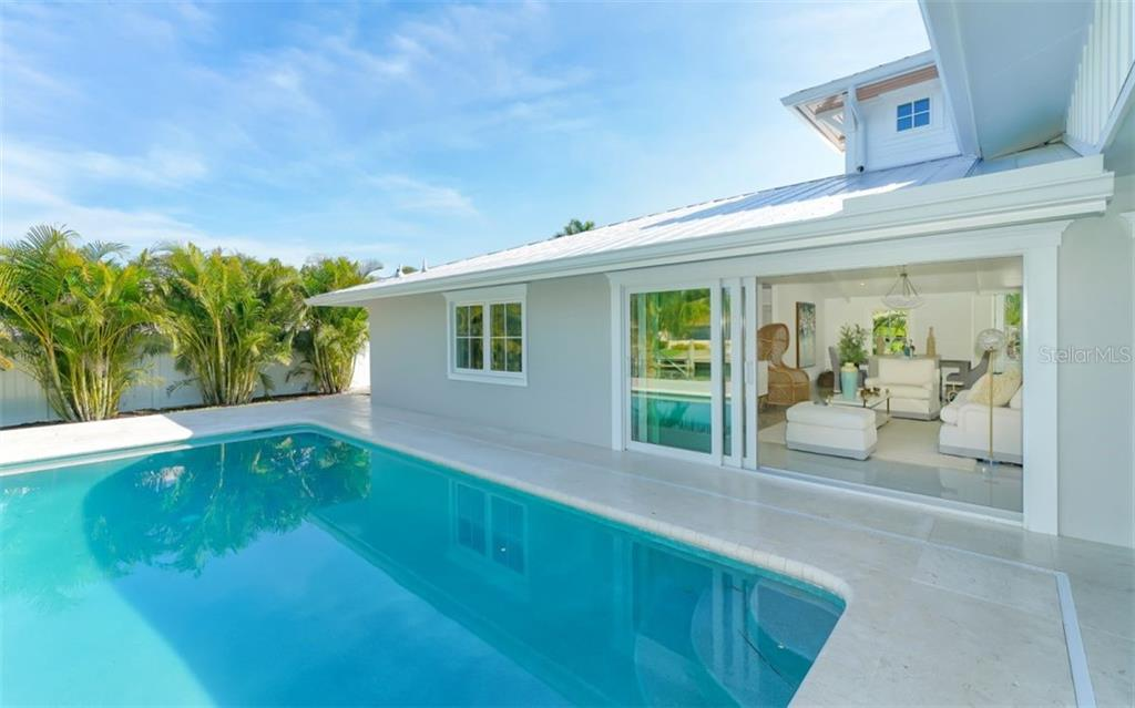 Single Family Home for sale at 511 Spinnaker Ln, Longboat Key, FL 34228 - MLS Number is A4453193