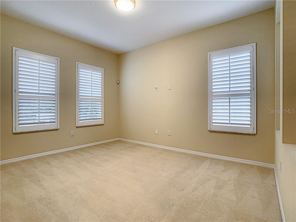 Office Downstairs with light, bright Windows.  Spacious, to say the least! - Single Family Home for sale at 8111 Santa Rosa Ct, Sarasota, FL 34243 - MLS Number is A4454464