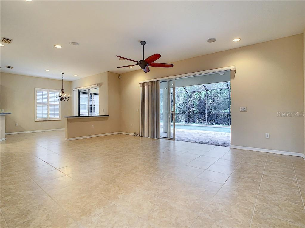 You have found the very spacious Family Room located at the rear of the home.  Wonderful view of Conservatory Park & Pool through the Triple Pocketing Sliders. Wow! - Single Family Home for sale at 8111 Santa Rosa Ct, Sarasota, FL 34243 - MLS Number is A4454464